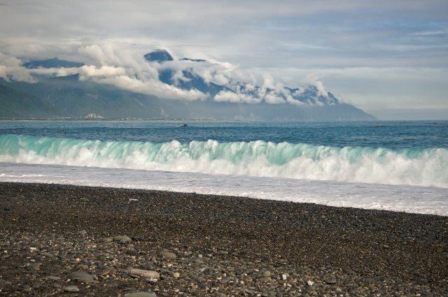CiSingTan Bay with fixed-net fishing operations close to shore, and the Central Mountain Range in the background, in Hualien County in Taiwan