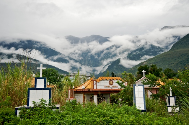Zuocang Cemetery in Hualient City, Taiwan, with the Central Mountain Range in the background