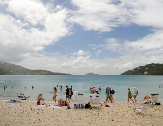 Magens Bay, St. Thomas, where tourists follow a waitress in bikini