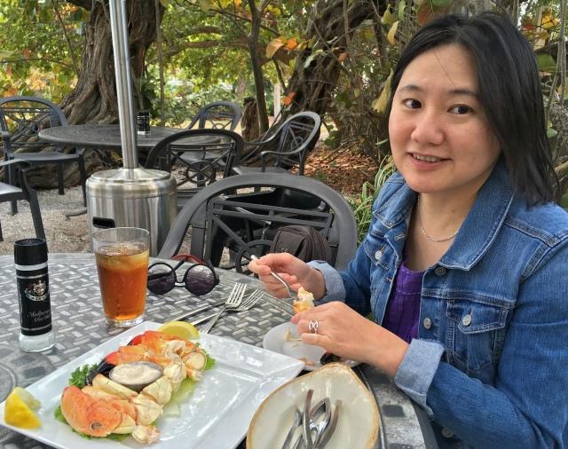 A happy customer enjoying stone crab