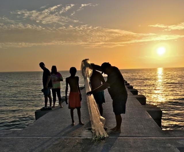 Cortez Beach Cast Net Fishing at Sunset