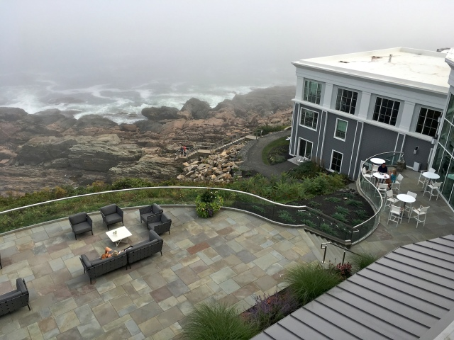 The terrace to the left, Tiller restaurant to the right, rocks and ocean in the background