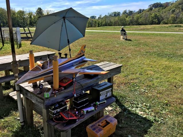 Versa-Brella shading a model jet at a flying field