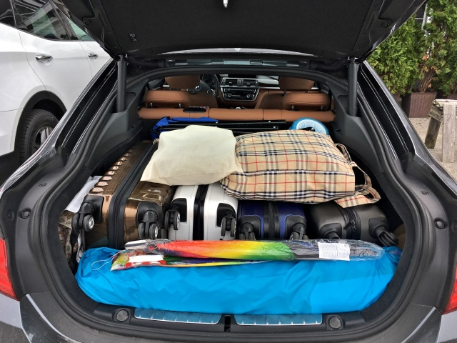 Packing beach equipment in the trunk of a car