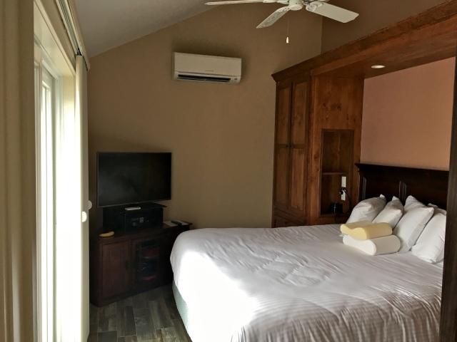 Tidal Suites at the Norseman Resort - bedroom with floor-to-ceiling sliding doors