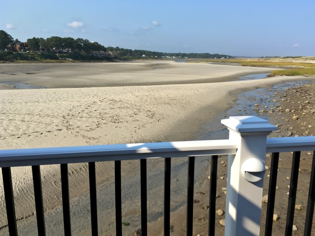Tidal Suites at the Norseman Resort - people walk on river bed at low tide