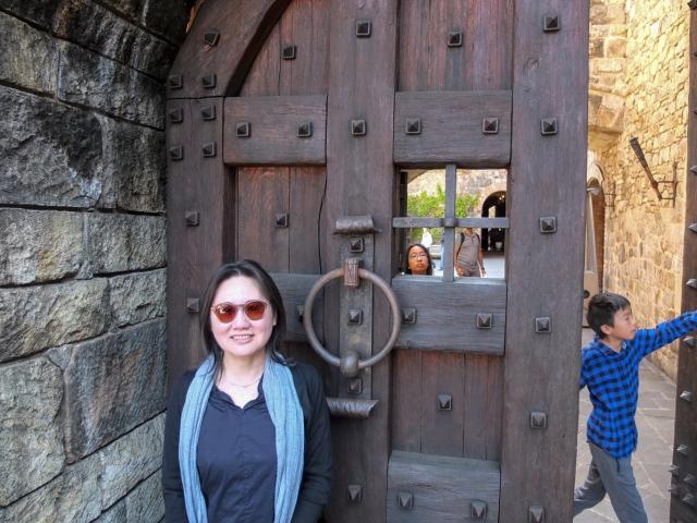 Massive wooden door with metal rivets/studs at Castello di