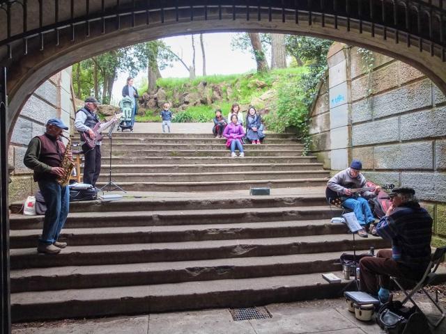 Street musicians performing in a pedestrian underpass at the Golden Gate Park