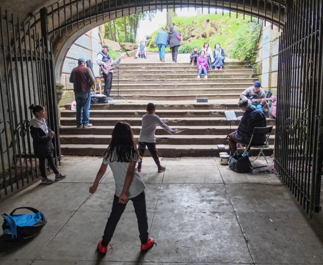 Street musicians performing in a pedestrian underpass at the Golden Gate Park