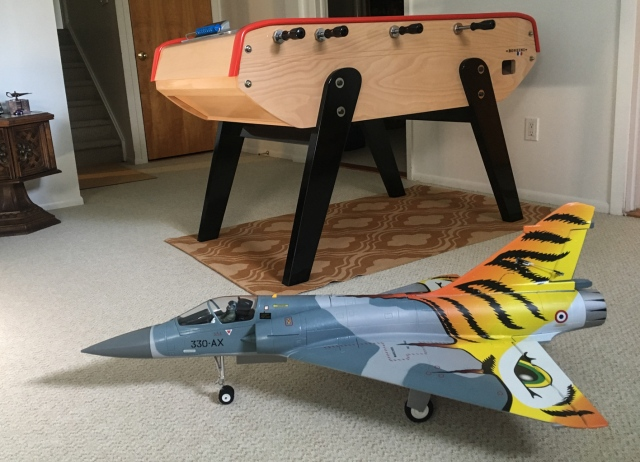 Freewing Mirage 2000 Tiger Meet , a French plane, in front of a French-style foosball table