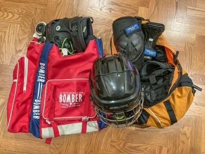 Street hockey equipment in backpacks