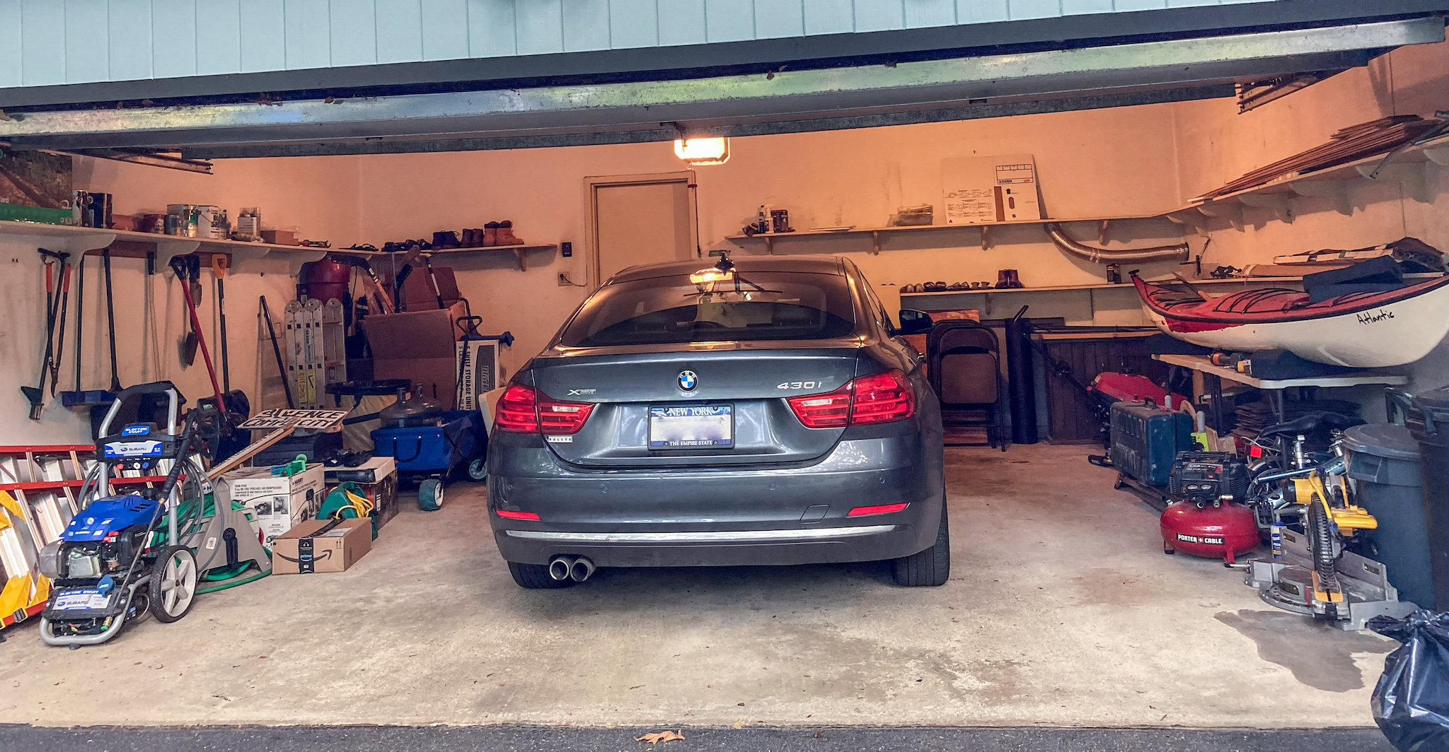 Garage before remodeling with tools and stuff strewn about