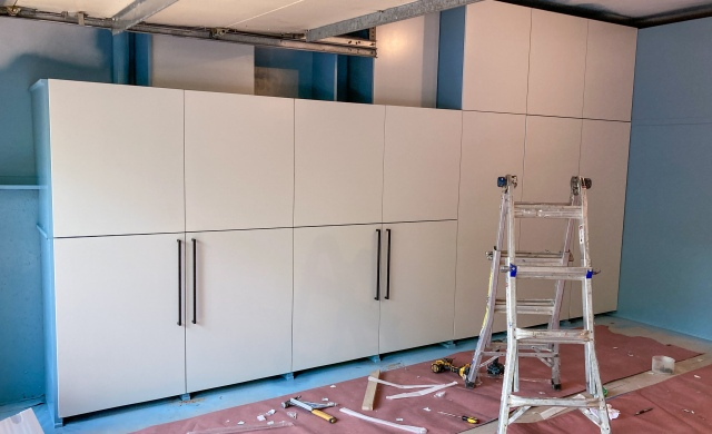 Handles are being installed on cabinet doors