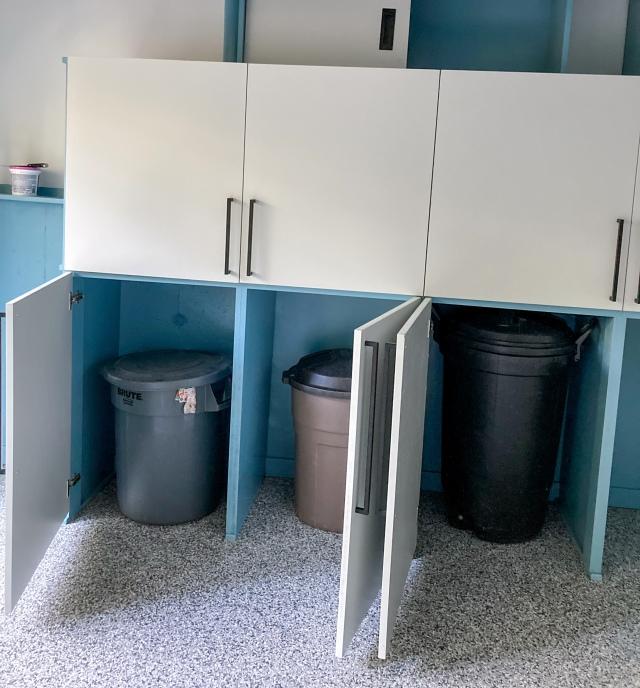 Trash cans safely hidden away behind cabinet doors