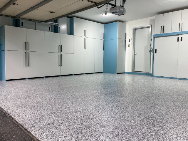 Finished look of the epoxy floor with new cabinets in the background