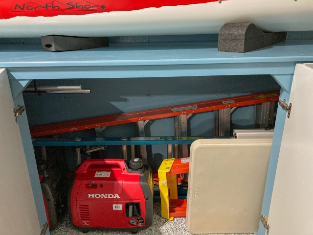 Storage space for ladders, flag pole, tree pruner, folding tables and inverters