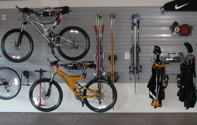 Slatwall in garage for bikes, skis, and golf clubs